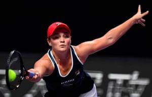 Ashleigh Barty stretches for, and makes, a forehand return to Karolina Pliskova.