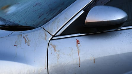 Blood is seen on a car at the scene of the brawl.