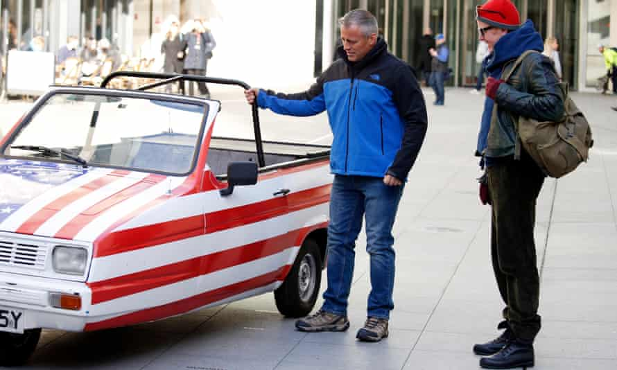 'But you promised me a Bugatti Veyron': Top Gear's Matt LeBlanc seems nonplussed as he looks at his three-wheeled Reliant Robin.