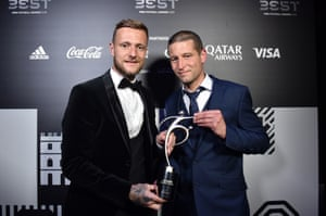 Liam Cooper, captain of Leeds United, and fitness coach Benoit Delaval receive the FIFA fair play award on behalf of Marcelo Bielsa.