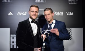 Leeds captain Liam Cooper and fitness coach Benoit Delaval receive the Fifa Fair Play Award in Milan.