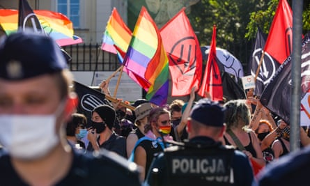 Showing solidarity … activists protest against an anti-LGBT far-right rally in Warsaw, on 16 August.
