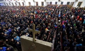 Churchgoers attend a Christmas Eve mass near the city of Taiyuan, Shanxi province.