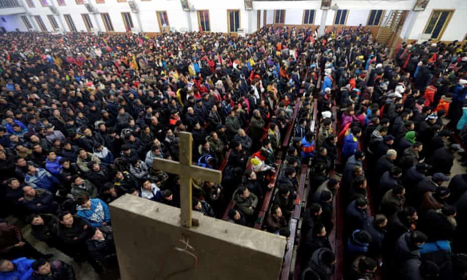 Churchgoers attend a Christmas Eve mass near the city of Taiyuan, Shanxi province.