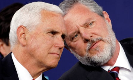 Jerry Falwell Jr confers with Mike Pence at Liberty University's commencement ceremony in Lynchburg, Virginia on Saturday.