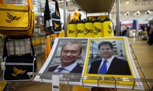 Posters of former Liberal Democrat leaders Tim Farron and Nick Clegg among items on sale during the second day of the party's conference