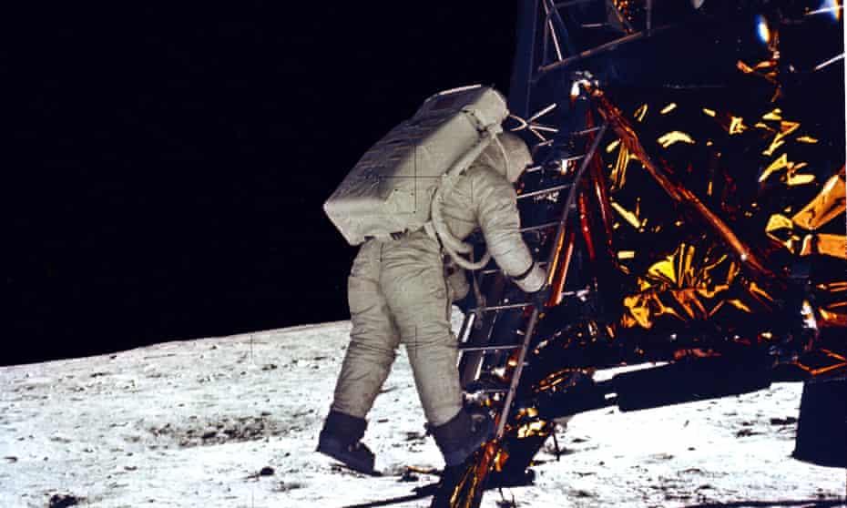 Buzz Aldrin descends from the lunar module.