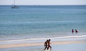 People escape Adelaide's heat on Henley beach.