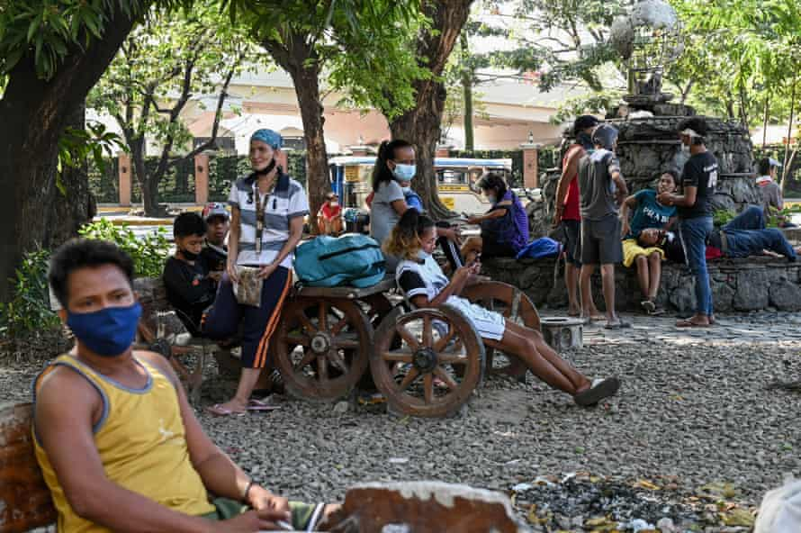 Homeless people wait for potential employers and food rations. Liwasang Bonifacio is one of Manila's 'freedom parks', where permission is not required to hold gatherings