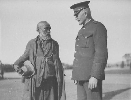 A NSW police officer talking to John Noble