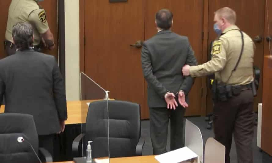 Derek Chauvin is led away in handcuffs after his conviction in Minneapolis on Tuesday.