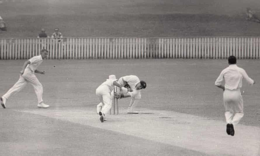 Rex Sellers bowling in a Sheffield Shield match against Queensland. Also pictured are John Lill (fielding), Sam Trimble (batting) and Barry Jarman (wicketkeeping).