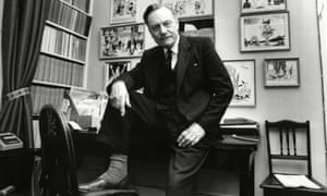 Enoch Powell sitting on his desk in his study at home
