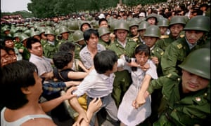 Amid growing tension, scuffles break out among protesters and security forces near the Great Hall of The People in June 1989.