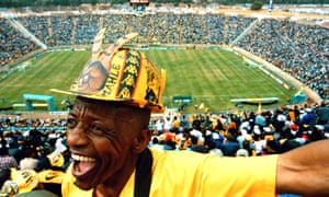 A Kaizer Chiefs fan displays his passion for the football club in the domestic cup final against Mamelodi Sundowns at FNB stadium in Soweto in 2000. The venue was rebuilt for the World Cup final hosted by South Africa in 2010