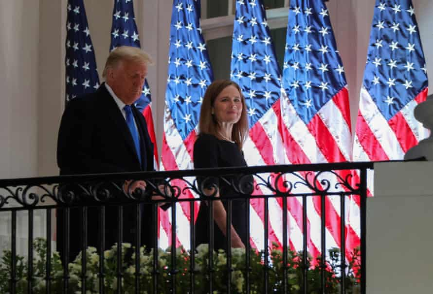 Judge Amy Coney appears at the White House with Donald Trump for the swearing-in ceremony.