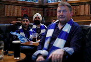 City fans watch the match at a city centre pub in Leicester.