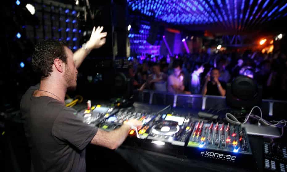 D.J. in a Paris night club. France.