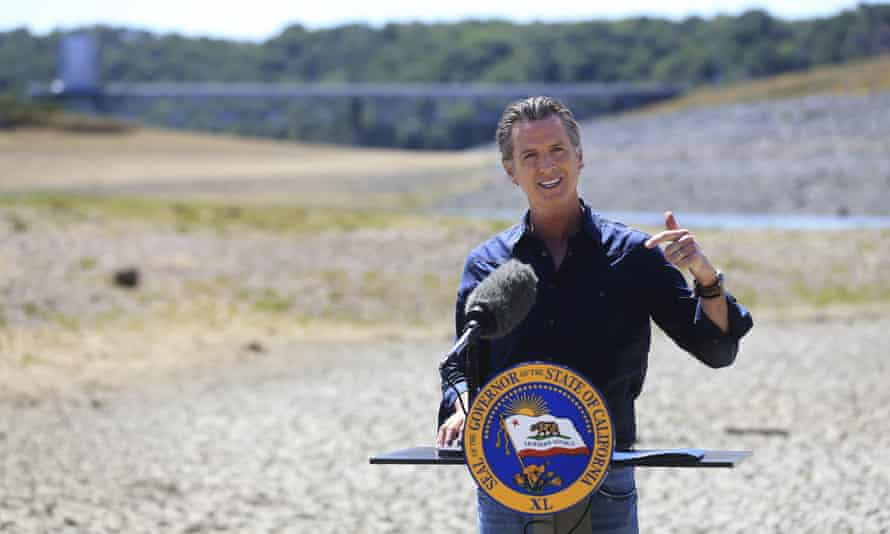 Gavin Newsom speaks at a news conference in the parched basin of Lake Mendocino in Ukiah, California, where he announced measures to combat drought.
