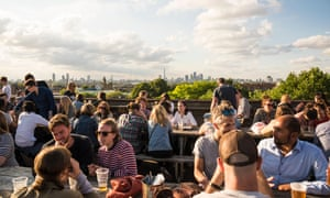 People socialising and enjoying a drink together at Franks Cafe outdoor rooftop bar