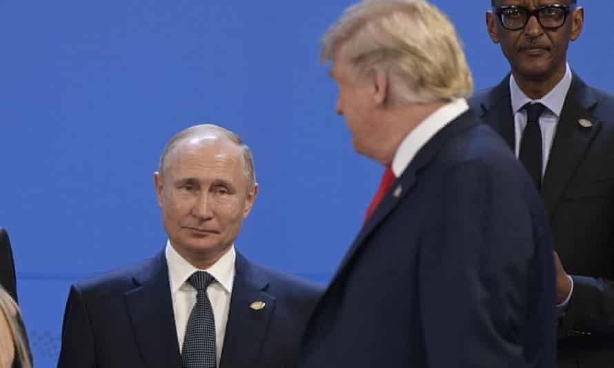Donald Trump looks at Vladimir Putin at the G20 leaders' summit