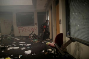 Protesters inside Minneapolis Police third precinct after the entrance was set on fire