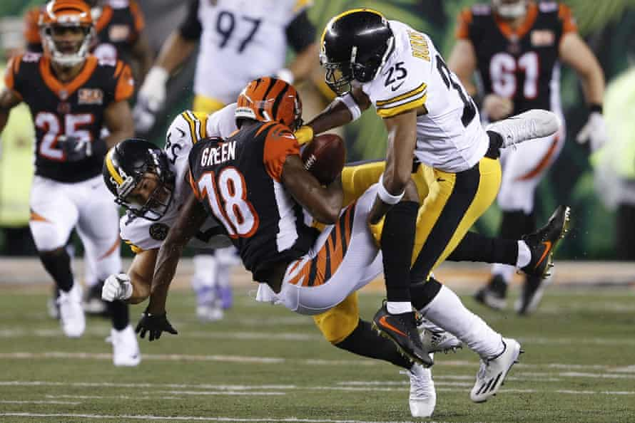 Cincinnati Bengals wide receiver A.J. Green (18) is tackled by Pittsburgh Steelers linebacker LJ Fort (54) and cornerback Artie Burns (25)
