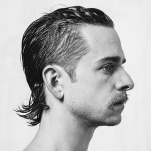 Black and white portrait of a mustachioed man in profile