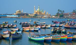 Colourful boats and a temple in the distance