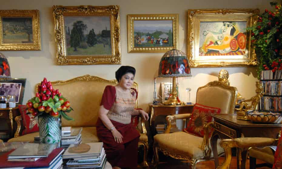 Imelda Marcos in her Manila apartment in 2007, surrounded by paintings including a Picasso
