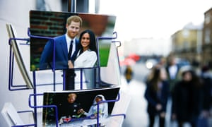 Merchandise depicting Prince Harry and Meghan, Duchess of Sussex, on display in a souvenir shop near Buckingham Palace in London