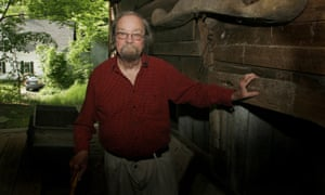In a 2006 photo, Donald Hall, author of numerous poetry books, poses in the barn of the 200-year-old Wilmot farm that has been in his family for four generations.