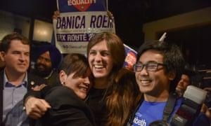 Democrat Danica Roem, centre, prepares to give a victory speech on Tuesday 7 November in Manassas, Virginia