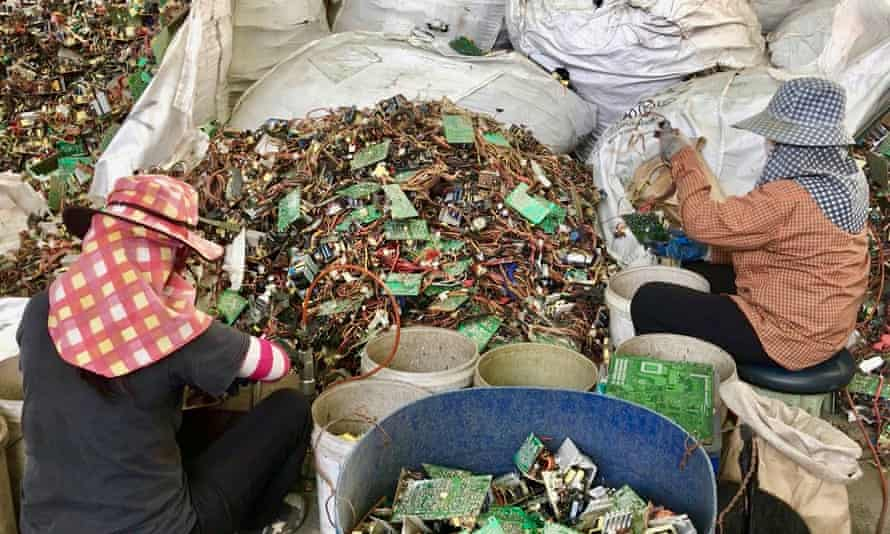 Electronic circuit boards are sorted at a site in Thailand