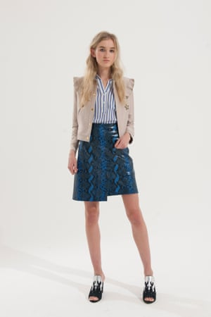 Beige cropped jacket with stars, blue and white striped shirt, blue and black vinyl animal print skirt, black and silver shoes