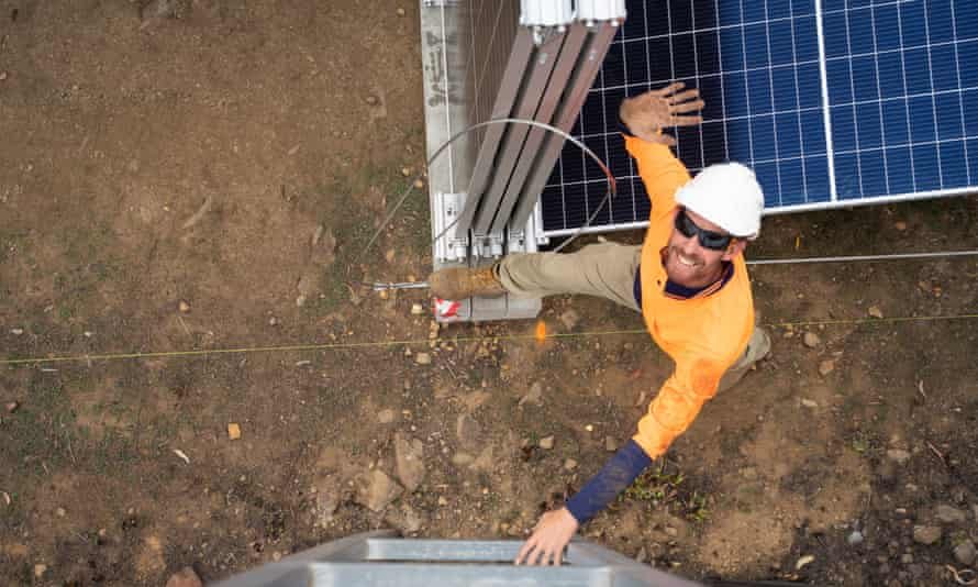 Jarrod Smith from solar company 5B installing solar and battery energy systems at Peak Alone, near Cobargo, New South Wales, Australia