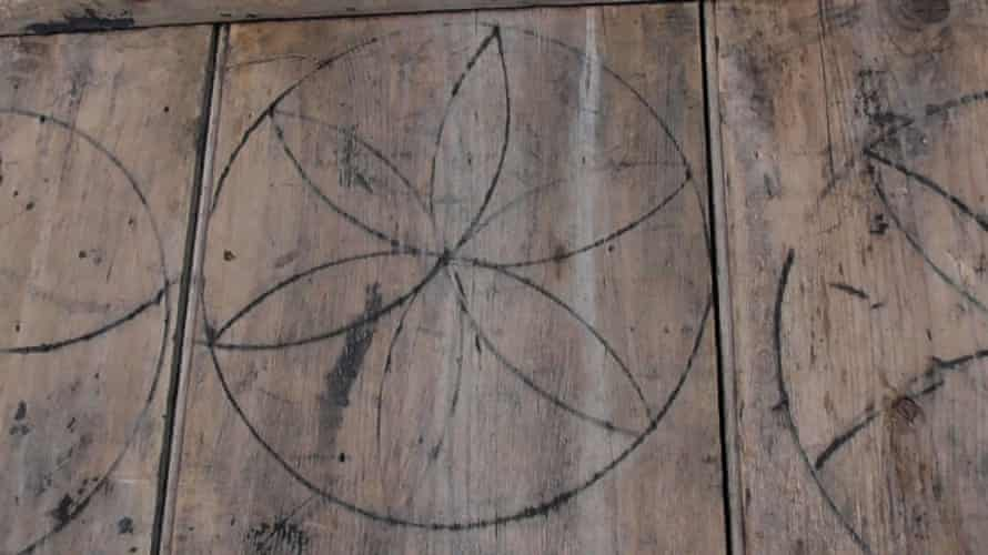 Witches' marks on a barn door in Laxfield, Suffolk.