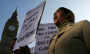 A demonstrator demands to be allowed to return to the Chagos Islands in a protest outside the Houses of Parliament.