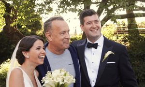 'No, you can't come on the honeymoon' … Tom Hanks crashes a wedding in Central Park.