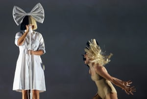 Singer SIA and dancer Maddie Ziegler perform at Allianz Stadium in Sydney in December. Following a column in the Guardian questioning fame-shy SIA's decision to thrust Ziegler into the spotlight at her own expense, SIA wrote on twitter of her conflicting feelings over utilising the dance prodigy in her work.