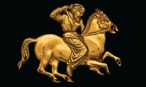 A gold plaque depicting a Scythian rider with a spear, part of the exhibition.