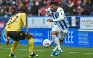 Huddersfield's Karlan Grant, here playing against Millwall, has been likened to Callum Wilson.