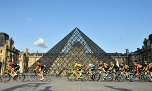 Team Ineos riders lead the 2019 race winner, Egan Bernal, past the Louvre on the way to the finish line in Paris.