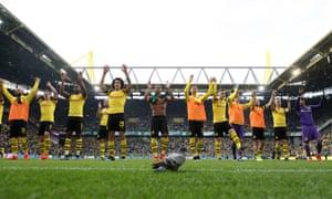 Borussia Dortmund celebrate their stoppage time victory over Wolfsburg.