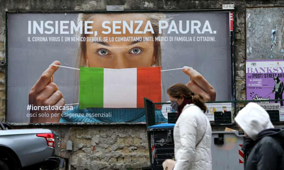 A billboard in Naples reads: 'All together, without fear'