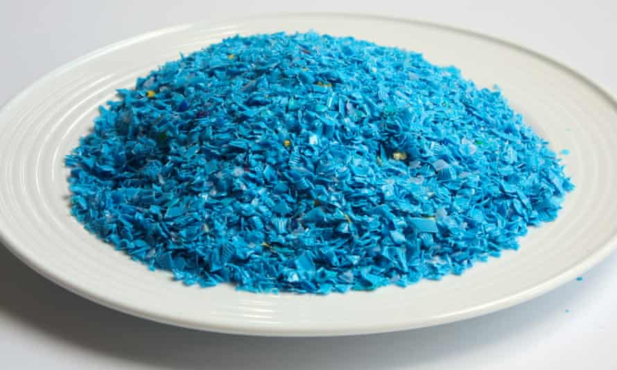 Recycled, shredded plastic is pictured on a dinner plate, equivalent to the amount of microplastic a person could consume in a year, according to a WWF study.