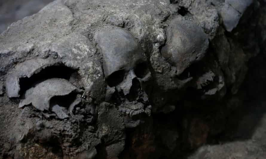 Skulls are seen at a site where more than 650, caked in lime, and thousands of fragments were found in a cylindrical edifice near Templo Mayor, in Mexico City.