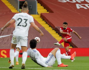 Mohamed Salah fires in his second, and Liverpool's third, goal.