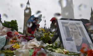 People view tributes for murdered Labour Party MP Jo Cox at Parliament Square in London
