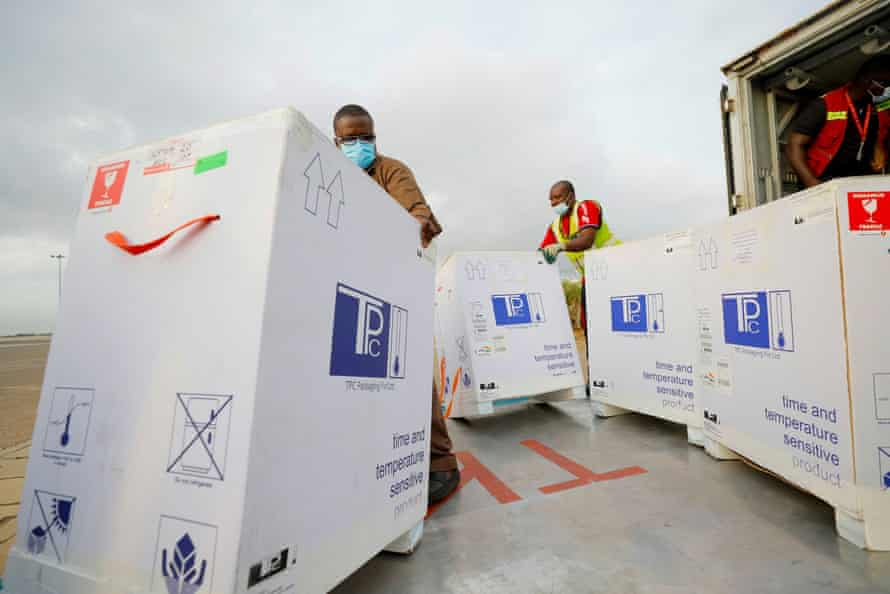 Airport workers in Ghana load a lorry with 350,000 AstraZeneca doses in May
